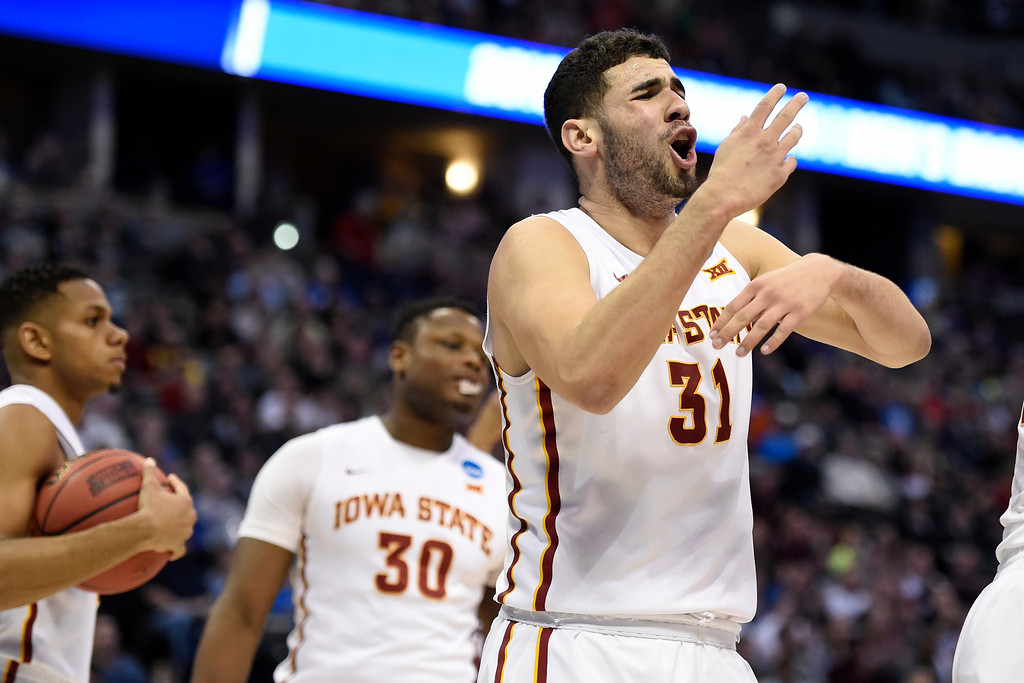 . DENVER, CO - MARCH 19: Georges Niang (31) of the Iowa State Cyclones reacts after expecting a traveling call against Lis Shoshi (12) of the Arkansas Little Rock Trojans during the first half of their second round NCAA Tournament game on Saturday, March 19, 2016. (Photo by AAron Ontiveroz/The Denver Post)