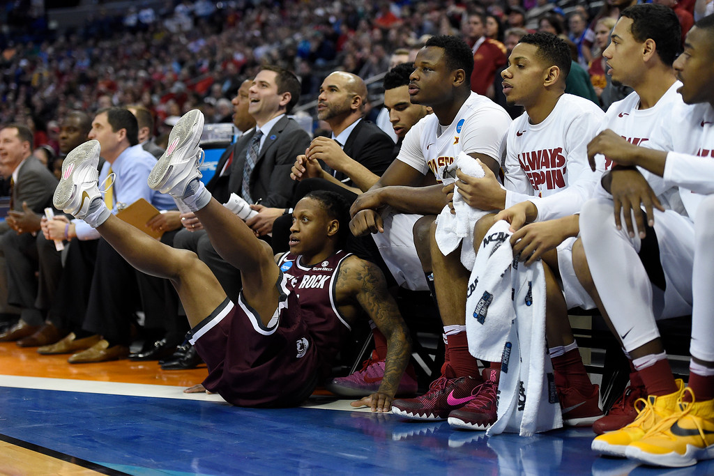. DENVER, CO - MARCH 19: Marcus Johnson Jr. (13) of the Arkansas Little Rock Trojans falls to the ground after being fouled by Jameel McKay (1) of the Iowa State Cyclones during the first half of their second round NCAA Tournament game on Saturday, March 19, 2016. (Photo by AAron Ontiveroz/The Denver Post)