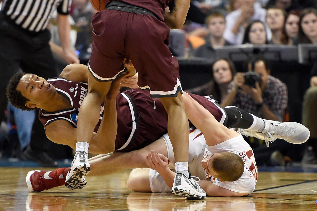 . DENVER, CO - MARCH 19: Matt Thomas (21) of the Iowa State Cyclones and Mareik Isom (14) of the Arkansas Little Rock Trojans tangle as they vie for a loose ball recovered by Marcus Johnson Jr. (13) during the second half of Iowa State\'s 78-61 second round NCAA Tournament game win on Saturday, March 19, 2016. (Photo by AAron Ontiveroz/The Denver Post)