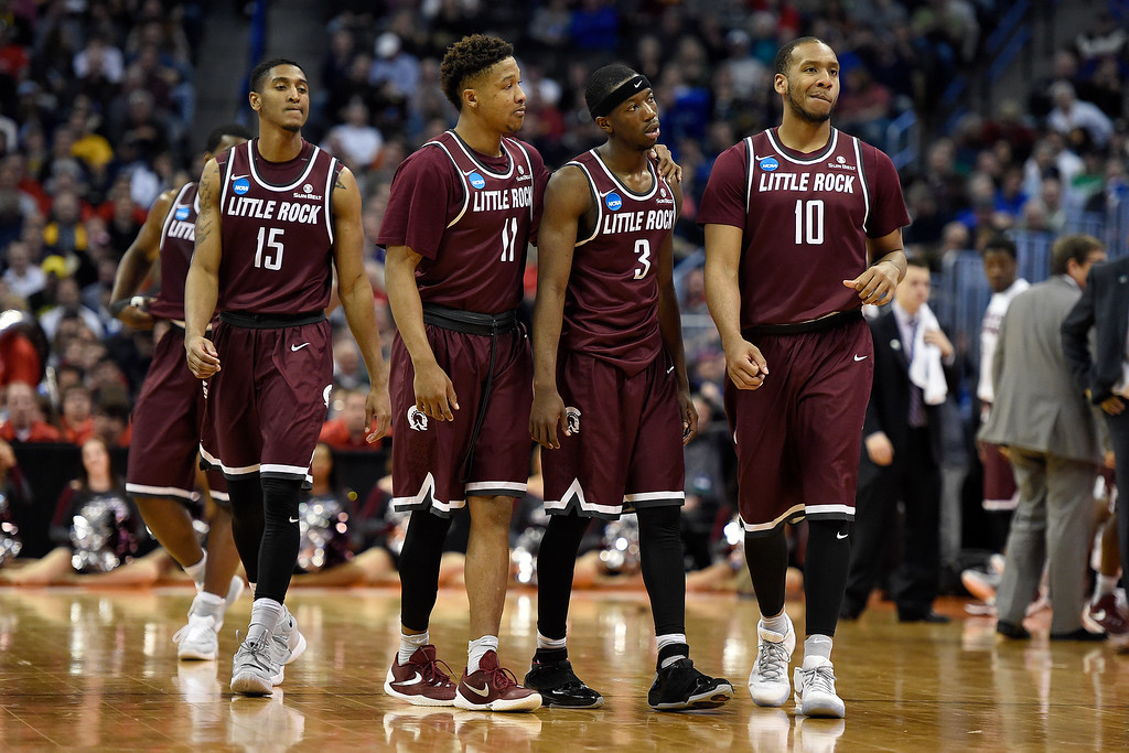 . DENVER, CO - MARCH 19: Stetson Billings (15) of the Arkansas Little Rock Trojans, Jermaine Ruttley (11), Josh Hagins (3) and Maurius Hill (10) walk on the court in the waning minutes against the Iowa State Cyclones during the second half of Iowa State\'s 78-61 second round NCAA Tournament game win on Saturday, March 19, 2016. (Photo by AAron Ontiveroz/The Denver Post)