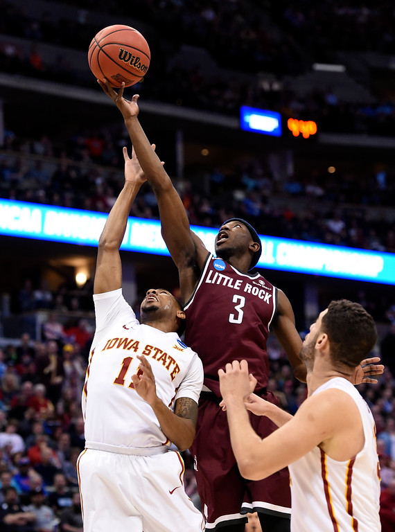 . DENVER, CO - MARCH 19: Arkansas Little Rock Trojans guard Josh Hagins (3) goes up high for a rebound over Iowa State Cyclones guard Monte Morris (11) in the second half during the second round of the men\'s basketball game in the NCAA Tournament March19, 2016 at Pepsi Center in Denver. Iowa State Cyclones defeated the Arkansas Little Rock Trojans 78-61. (Photo By John Leyba/The Denver Post)