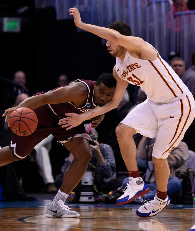 . DENVER, CO - MARCH 19: Arkansas Little Rock Trojans forward Roger Woods (0) tries to drive on Iowa State Cyclones forward Georges Niang (31) in the first half during the second round of the men\'s basketball game in the NCAA Tournament March19, 2016 at Pepsi Center in Denver. (Photo By John Leyba/The Denver Post)