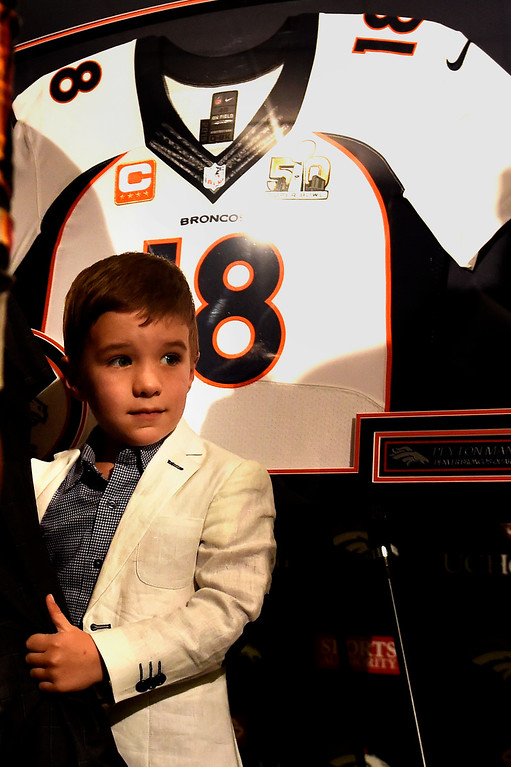 . ENGLEWOOD, CO - MARCH 07: Denver Broncos quarterback Peyton Manning\'s 4 year old son Marshall hangs onto daddy\'s leg after a press conference to announce his retirement from the NFL at UCHealth Training Center March 7, 2016 at UCHealth Training Center in Englewood, CO. (Photo By Joe Amon/The Denver Post)