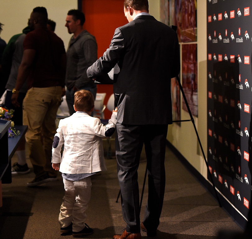 . ENGLEWOOD, CO - MARCH 07: Denver Broncos quarterback Peyton Manning and his 4 year old son Marshall walk away from the podium after a press conference to announce his retirement from the NFL at UCHealth Training Center March 7, 2016 at UCHealth Training Center in Englewood, CO. (Photo By Joe Amon/The Denver Post)