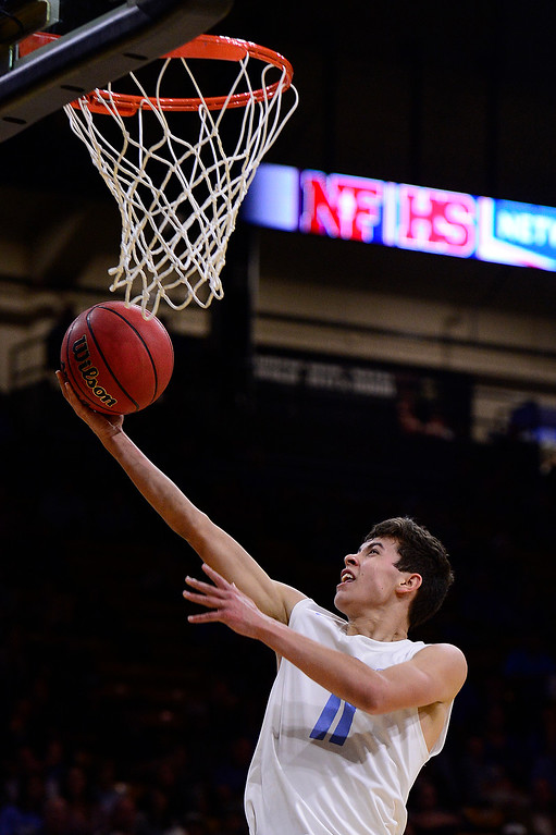 . David Simental (11) of Pueblo West easily lays one in on a breakaway during the fourth quarter at the Coors Events Center on March 11, 2016 in Boulder, Colorado. Pueblo West defeated Vista Ridge 65-54 to advance to the 4A finals of Colorado state basketball tournament.  (Photo by Brent Lewis/The Denver Post)