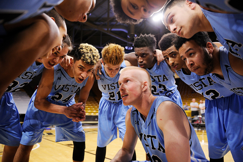 . Vista Ridge gathers around Jake Goggin (10) before the start of the game at the Coors Events Center on March 11, 2016 in Boulder, Colorado. (Photo by Brent Lewis/The Denver Post)