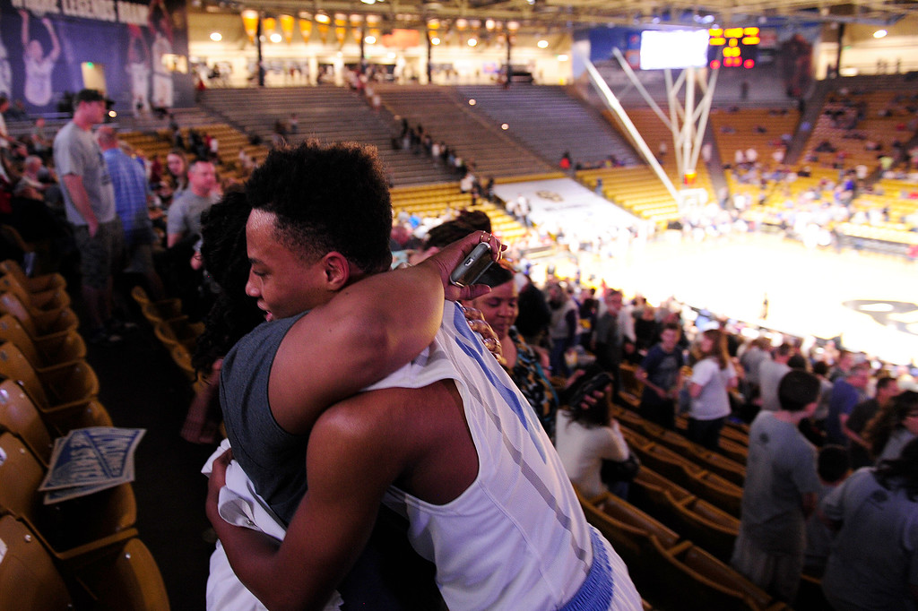 . Pierre Taylor (13) of Pueblo West hugs his mother, Stephanie Hughes, after defeating Vista Ridge to advancce at the Coors Events Center on March 11, 2016 in Boulder, Colorado. Pueblo West defeated Vista Ridge 65-54 to advance to the 4A finals of Colorado state basketball tournament.  (Photo by Brent Lewis/The Denver Post)