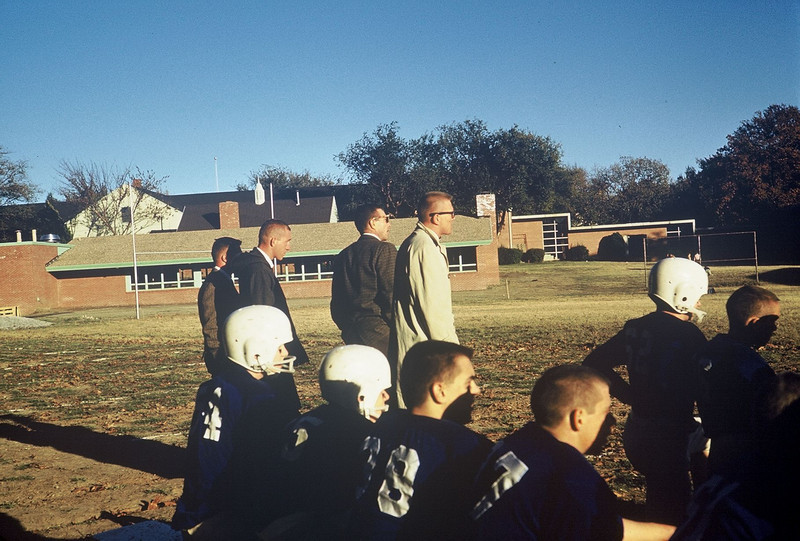 Football game at the Holland Hall School.  Steve Booth in the light tan raincoat.  Ed Hooker immediately to his left.