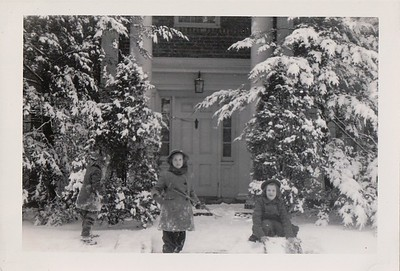 Hattie and Mary Riddle, with Isabel, sledding at the Riddles' rented house, Dec. 1944.