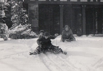 Hattie and Mary Riddle, with Isabel, sledding at the Rosemont house, Dec. 1944.