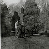 Bosie, Gerry and Isabel decorating the outdoor Christmas tree in Dec. 1944.