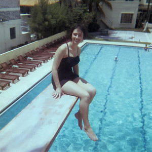 Me (Mom) sitting on the diving board above the hotel pool.