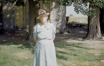Grandma Baadsgaard, in front of the house Foster grew up in. Lake Shore.