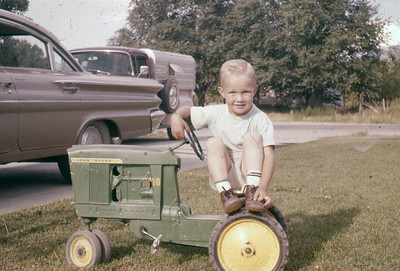 Scott Johnson, late 1950's, with his tractor in Spanish Fork.