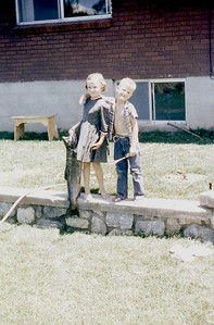 Toni and Curtis Johnson holding a 15 # salmon, Spanish Fork UT. 1950s.