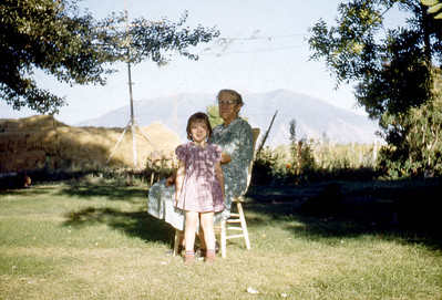 Evelyn Baadsgaard front, Margaret Baadsgaard sitting, at the farm at Lake shore Ut. 1950s