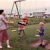 Back yard of 308 Tupelo--Mom, Bill (hidden), Paul, Me, Rich