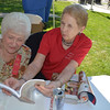 Millie Lask, left, and Vera Keplar peruse a work of local history at the Old Settlers Reunion Sept. 27.