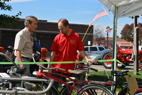 Rich Weishaar, left, talks about old bicycles with Nathan Painter at the Old Settlers Reunion. Weishaar collects bicycles from the mid 20th century.