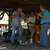 Bob Hubbartt plays the harmonica during the Big Spike Hammer concert at the Old Settlers Reunion Sept. 27. Other musicians pictured are Travis Hildebrand on banjo, Don Croft on standup bass and Tom Benton on guitar.