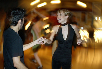 Cid Galicia (left) dances with Mindy Moore (right) at Matthews' Cafe Saturday Night. Because the venue has offered many dance oppourtunities, Luke Scherba is going to be opening a new dance studio called Studio One. - halley photo 7/15/06