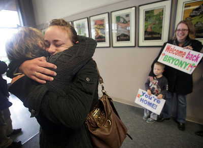 Lily English (left) embraces her daughter Bryony English (center), as she returns home to family and friends, including Michelle Martin and son Walker Martin, 4 (right) at Chico Airport Friday , March 18, 2011 in Chico, Calif. Bryony was in Japan during the 8.9 earthquake and tsunami that hit last week.  (Jason Halley/Chico Enterprise-Record)