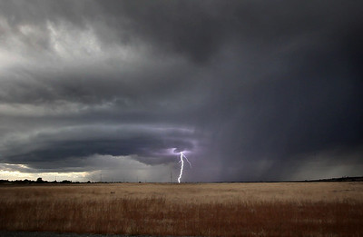 Lightning strikes and rain falls over north Chico as seen from Upper Park  as a thunder and hail storm blew through the area creating havoc and power outages Wednesday, October 5, 2011 in Chico, Calif. (Jason Halley/Chico Enterprise-Record)