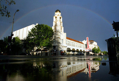 The sunset showed a rainbow appear in the dark rain clouds over the Senator Theater on Wednesday, April 28, 2010 in Downtown Chico, Calif. (Jason Halley/Chico Enterprise-Record)