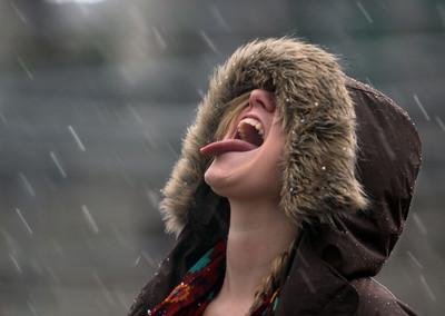 Callie McMurray, 19, sticks out her tongue to catch soft snow-like hail that fell as people walk by Chico State BMU on the CSUC campus Friday, February 25, 2011 in Chico, Calif. (Jason Halley/Chico Enterprise-Record)