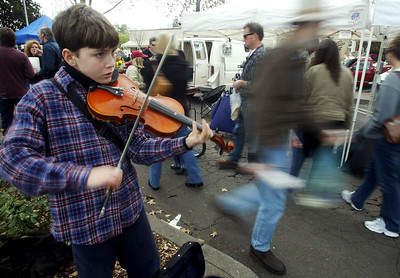 Dragor Cochrane, 12, plays his violin at the Saturday's Farmer's Market. - halley photo 3/4/06