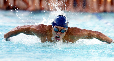 Pleasant Valley's David Hernandez, 17, competes in the 100 Butterfly swim during their swim meet against Chico High at InMotion Fitness Wednesday. - halley photo 10/11/06