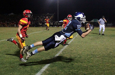 Pleasant Valley High's #12 Chase Drews (right) lays out for a completed catch in the endzone to score a touchdown against Chico High's #9 Jesse Holmes (left) in the second quarter of their Almond Bowl football game at CSUC University Stadium Friday, October 22, 2010 in Chico, Calif. (Jason Halley/Chico Enterprise-Record)