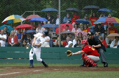 The crowd dawned umbrellas for the rain as PV High's #10 Joseph Grap makes contact with a pitch against Chico High in the bottom of the second inning during the NSCIF Baseball Championship game Friday at Doryland field at the Hooker Oak complex. - halley photo 5/19/06