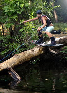 Raequel Hoffman wakeboards in Big Chico Creek using a wench to tow her for a few feet in the low water level in Lower Bidwell Park on Thursday, July 17, 2008 in Chico, CA.  (Jason Halley/Chico Enterprise-Record)