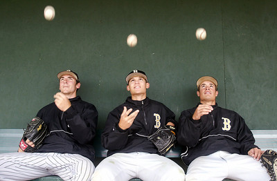 Butte College baseball starting pitchers Matt Davis, Derrick Miramontes, and Garrett Hamilton (left to right) are an outstanding set of pitchers for the team. Here they pose for a feature story. - halley photo 3/30/06