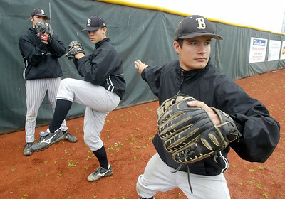 Butte College baseball starting pitchers Matt Davis, Derrick Miramontes, and Garrett Hamilton (left to right) are an outstanding set of pitchers for the team. Here they pose in three sets of the pitching throw for a feature story. - halley photo 3/30/06