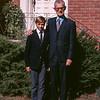 Peter Lantz in Albert College blazer with Lloyd Lantz in front of front door.
