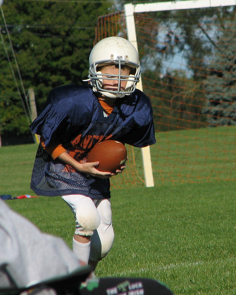 Grant playing football.