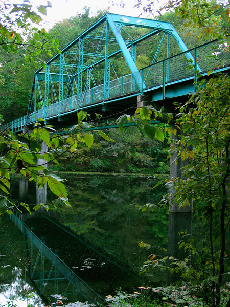 The vintage one lane bridge was moved from another Manchester location after it was learned that it would be replaced by a modern two lane structure.