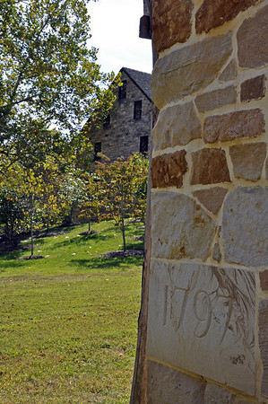Cornerstone of the George Washington Distillery overlooking the Gristmill