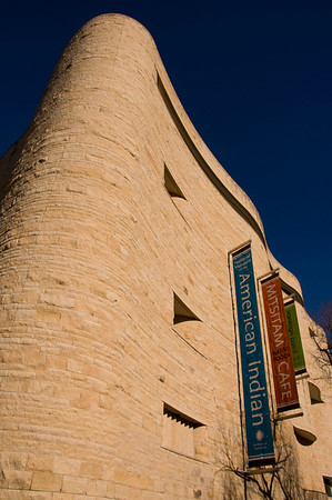 The American Indian Museum against an azure blue sky