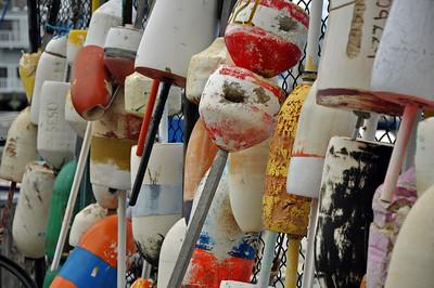 Colorful buoys along the fence at the Marina