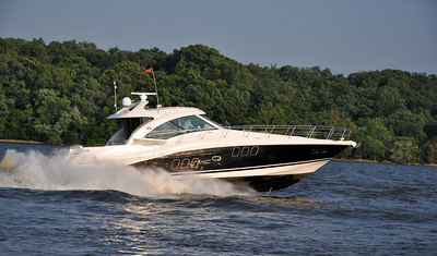 A Sea Ray 55' Sundancer slicing through the waters of the Potomac River