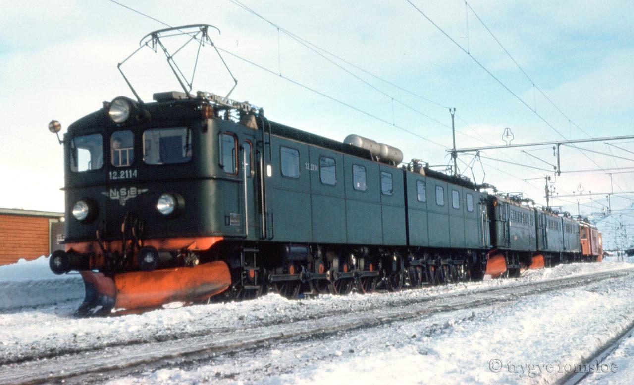 NSB El 12 2114  + unknown. NSB El 3 behind. Bjoernfjell st unknown date by Trygve Romsloe sen