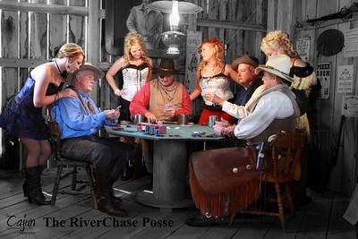 "The RiverChase Posse playing a game of cards with the Saloon Girls at their side.   The Card Game took place at the 13th Annual Ole Timey Craft & Bluegrass Festival in Estillfork, Alabama on September 27th thru the 29th of 2013. The Gunfight was performed by The Riverchase Posse ""An Old West Living History Re-Enactment Troop"".  Photography By: The Cajun, Lloyd R. Kenney III ©2013 All Rights Reserved. Email: lloydkenneyiii@gmail.com"