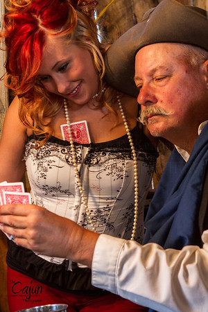 """The RiverChase Posse playing a game of cards with the Saloon Girls at their side.   The Card Game took place at the 13th Annual Ole Timey Craft & Bluegrass Festival in Estillfork, Alabama on September 27th thru the 29th of 2013. The Gunfight was performed by The Riverchase Posse """"An Old West Living History Re-Enactment Troop"""".  Photography By: The Cajun, Lloyd R. Kenney III ©2013 All Rights Reserved. Email: lloydkenneyiii@gmail.com"""