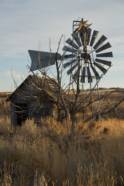 Falling windmill and outbuilding.