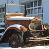 Old International flat bed truck covered in snow.