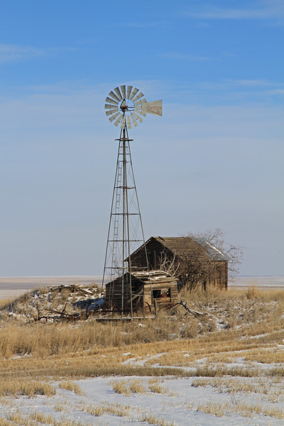 Abandoned windmill and out buildings.