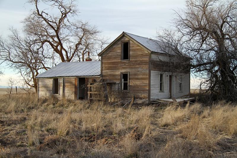 Faded white farmhouse.